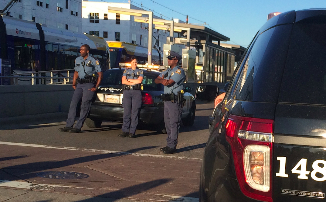 Police escort along University Ave.