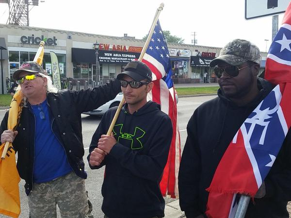 Close-up of the white supremacists. The one on the left is named BC Johnson, the organizer of the Confederate Flag rally at the capital earlier this month.